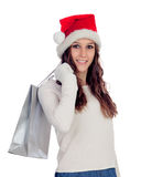 Attractive casual girl with Christmas hat shopping Stock Photos