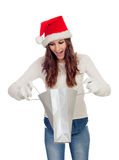 Attractive casual girl with Christmas hat shopping Stock Image