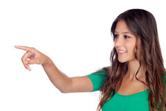 Attractive casual girl in green indicating something Royalty Free Stock Photography