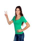 Attractive casual girl in green making the sign of victory Stock Photos
