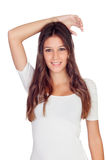 Attractive casual girl with his arm over his head Royalty Free Stock Photos