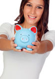 Attractive casual girl with moneybox Royalty Free Stock Images