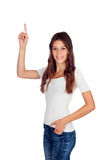 Attractive casual girl pointing up Royalty Free Stock Photography