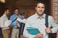Attractive casual mature student posing in corridor Royalty Free Stock Photos