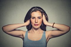 Attractive casual woman covering with hands her ears Royalty Free Stock Images