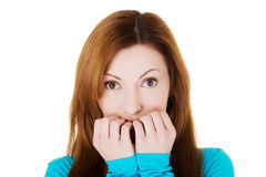 Attractive casual woman expressing fear/ worries. Royalty Free Stock Images