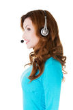 Attractive casual woman with headphones and microphone. Royalty Free Stock Photos