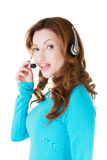 Attractive casual woman with headphones and microphone. Stock Image