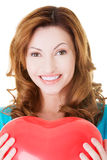 Attractive casual woman holding a balloon heart. Royalty Free Stock Images