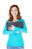 Attractive casual woman holding an open book. Royalty Free Stock Image