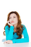 Attractive casual woman lsitting and looking up. Royalty Free Stock Photos