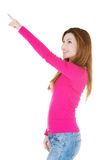 Attractive casual woman pointing up. Stock Image