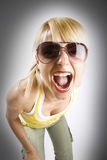 Attractive casual woman screaming Stock Photo