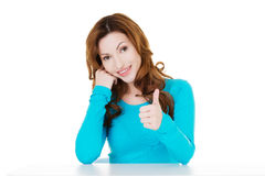 Attractive casual woman showing OK. Stock Photo