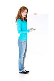 Attractive casual woman writing on copy space. Royalty Free Stock Images