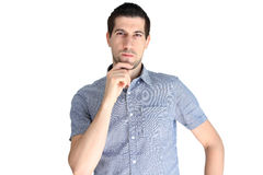Attractive casual young man concentrating Royalty Free Stock Images