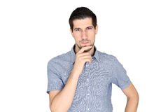 Attractive casual young man concentrating. A portrait of attractive casual young man concentrating Stock Images