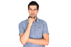 Attractive casual young man concentrating. A portrait of attractive casual young man concentrating Royalty Free Stock Images