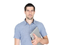Attractive casual young man holding laptop. A portrait of attractive casual young man holding laptop Royalty Free Stock Photography