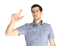 Attractive casual young man pointing his finger. A portrait of attractive casual young man pointing at something Royalty Free Stock Images