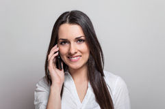 Attractive casual young woman talking on her mobile phone Royalty Free Stock Images