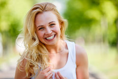 Attractive caucasian blond girl in countryside Royalty Free Stock Photo