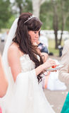 Attractive caucasian bride eating strawberry outdoors Stock Photo