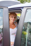 Attractive caucasian bride sitting in car Royalty Free Stock Photos