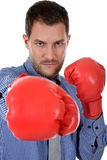 Attractive  caucasian businessman, boxing gloves Royalty Free Stock Images