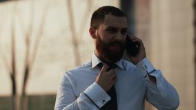 Attractive caucasian businessman using smartphone stock footage