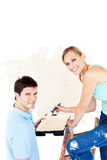 Attractive caucasian couple painting a room Royalty Free Stock Photos