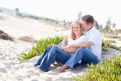 Attractive Caucasian Couple Relaxing at the Beach Stock Image