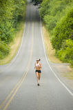 Attractive Caucasian Female Runner on Country Road Stock Image