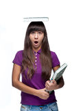 Attractive caucasian funny girl holding book Royalty Free Stock Photography