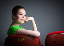Attractive caucasian girl in her 30 shot in studio. Attractive caucasian woman in the theatre in her 30 isolated on a grey background Royalty Free Stock Photos