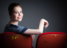 Attractive caucasian girl in her 30 shot in studio. Attractive caucasian woman in the theatre in her 30 isolated on a grey background Stock Image