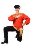 Attractive caucasian guy dancing in folk costume Stock Image