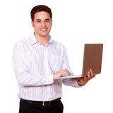 Attractive caucasian guy using his laptop Stock Images