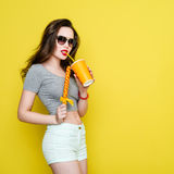 Attractive Caucasian joyful woman with a paper cup of juice and Stock Images