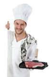 Attractive caucasian male chef, t-bone steak. Royalty Free Stock Photo