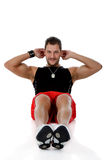 Attractive caucasian man, abdominal exercises Royalty Free Stock Photos