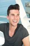 Attractive caucasian man laughing outdoors Royalty Free Stock Photography