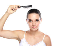 Attractive caucasian model using hair comb Stock Image