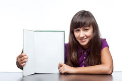 Attractive caucasian smiling girl holding book Stock Images