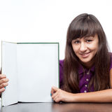 Attractive caucasian smiling girl holding book Stock Photos