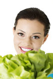 Attractive caucasian smiling woman with salat Stock Image