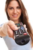Attractive caucasian woman with  TV remote Stock Photography