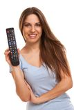 Attractive caucasian woman with  TV remote Royalty Free Stock Image