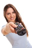 Attractive caucasian woman with  TV remote Royalty Free Stock Images