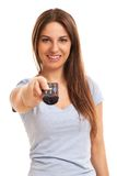 Attractive caucasian woman with  TV remote Stock Photo